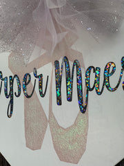 Personalized Wood Heart shows an up close image of the glitter name and ballet shoes and tulle used.