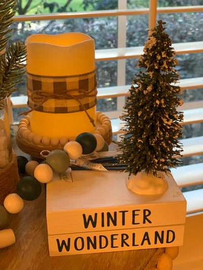 Winter Wonderland Wooden Books is shown with a candle, beaded garland, pine greenery.  Each item sold separately.
