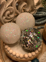 This image show the glitter snowballs sitting on the riser.  Each item sold separately.