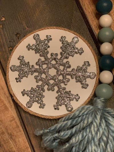 Double Sided Silver Glitter Snowflake is shown with a strand of our beaded garland in sea glass green.