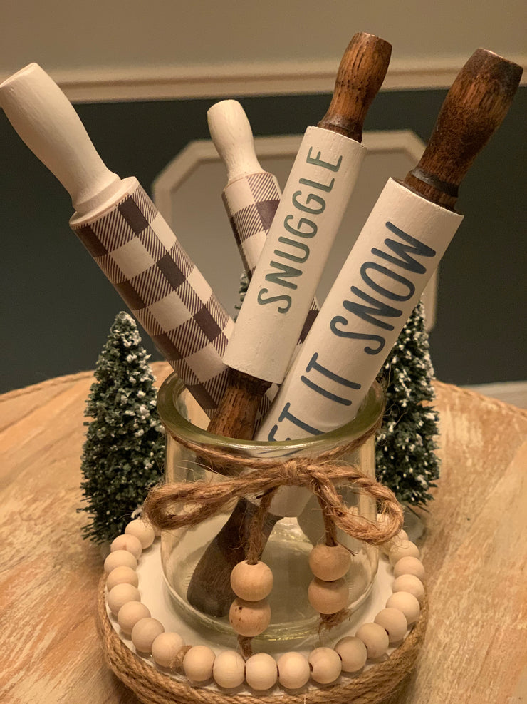 "This image shows both the 5"" an 7"" buffalo plaid and the 5"" snuggle and 7"" let it snow rolling pins together."