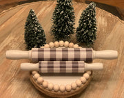 "Buffalo Plaid Mini Rolling Pins is showing both the 5"" and 7"" pins together."