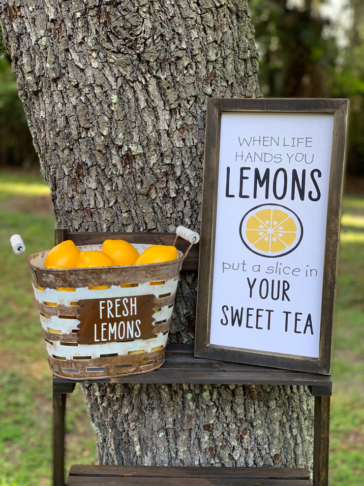Small Olive Fresh Lemons Basket is displayed outside on a ladder with the Sweet Tea sign. Each item sold separately.