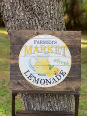 Farmer's Market Fresh Lemonade (Metal and Wood Pallet Sign) shows an image of the pallet sign displayed outside on a ladder shelf.