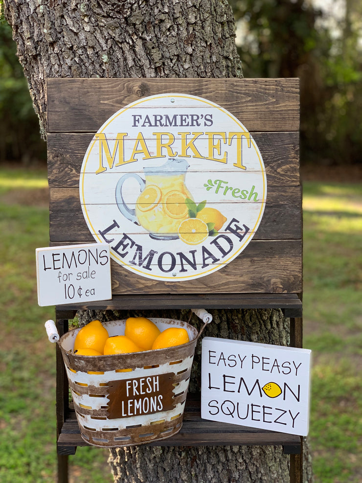 Farmer's Market Fresh Lemonade (Metal and Wood Pallet Sign) shows an alternative image of the pallet sign displayed with a basket of lemons, and two smaller white block signs.  Each item sold separately.