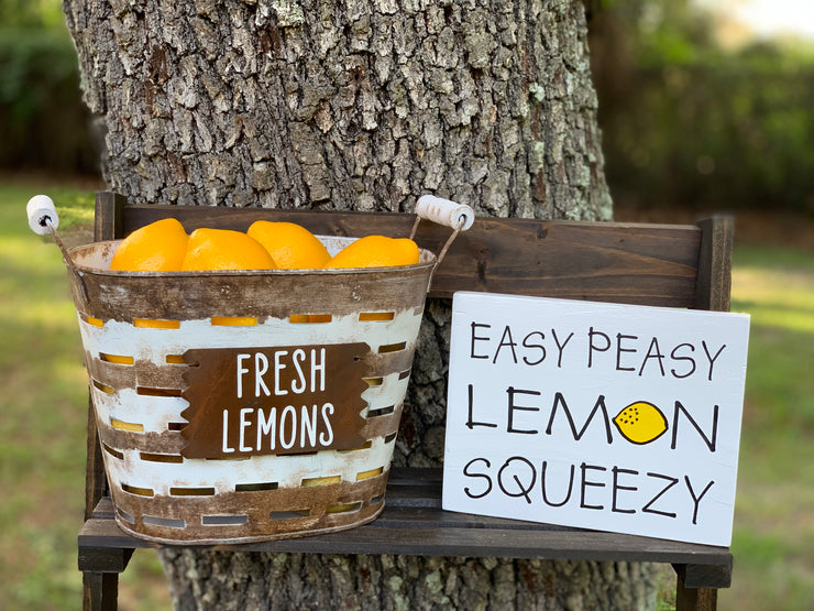 Small Olive Fresh Lemons Basket is displayed on a outside ladder with the Easy Peasy Lemon Squeezy sign.  Each item sold separately.