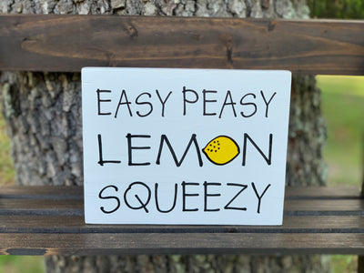 Easy Peasy Lemon Squeezy is displayed outside on a ladder.