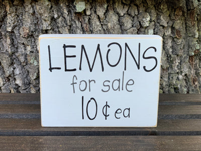 Lemons For Sale 10 Cents Each shows an image of the block sign sitting on a ladder outside.