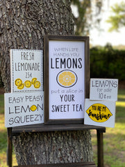 Easy Peasy Lemon Squeezy shows an alternative image of the sign displayed on a ladder outside with other lemon signs.  Each sign sold separately.