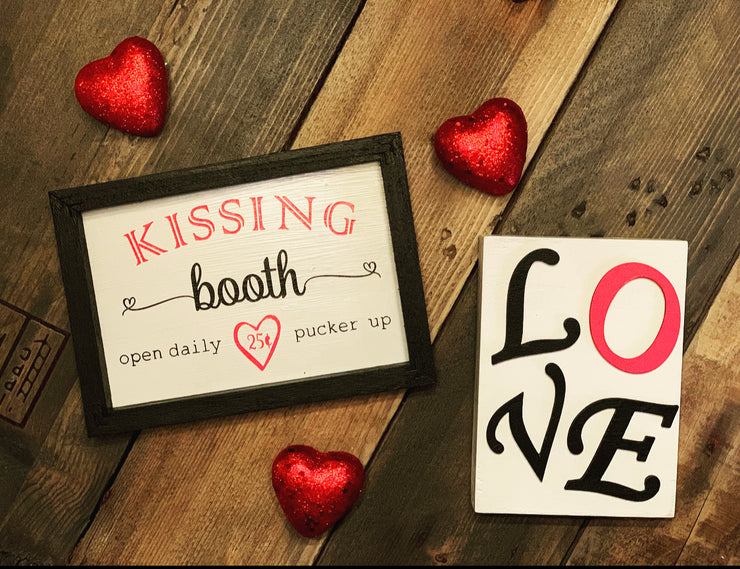 This mini tiered tray Kissing Booth sign is shown paired with our 3D Love wood sign and decorative red heart embellishments.  Each sign sold separately.