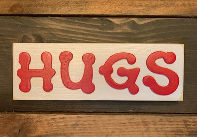 Valentine Hugs 3D Block Sign shows an image of the white sign with 3D wood lettering in red.