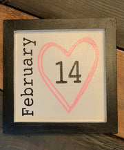 February 14 Mini Wood Sign shows the sign sitting on a wood table.