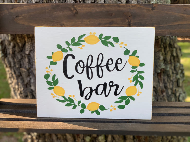 Coffee Bar (Lemon Wreath) shows an image of the small sign sitting on a ladder outside.