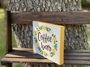 Coffee Bar (Lemon Wreath) shows an alternative image of the sign at a side view angle displaying the yellow border.
