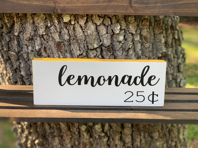 Lemonade 25 Cents shows an image of the small block sing sitting on a ladder outside.