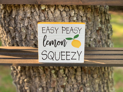Easy Peasy Lemon Squeezy (small block sign) shows an image of the small block sign sitting on a ladder outside.