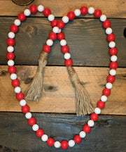 This image shows the red and white bead garland.