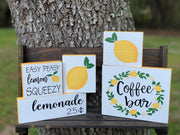 Coffee Bar (Lemon Wreath) shows an image of the sign with other lemon signs as a grouping together.  Each sign is sold separately.