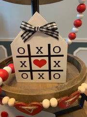Mini House XOXO Wood Sign is shown sitting on a tiered tray.