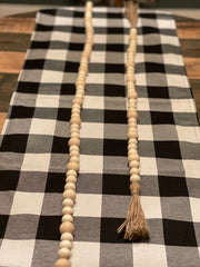 This image shows the natural bead garland side by side in length.