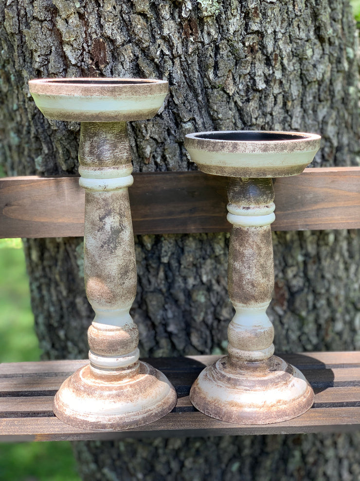 Rustic Candlesticks shows the linen white and antique brown medium and small candlesticks together.  Each sold separately.