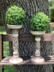 Rustic Candlesticks shows am image of the medium and small linen white and antique brown candles together.  Embellishments are not sold with candlesticks.