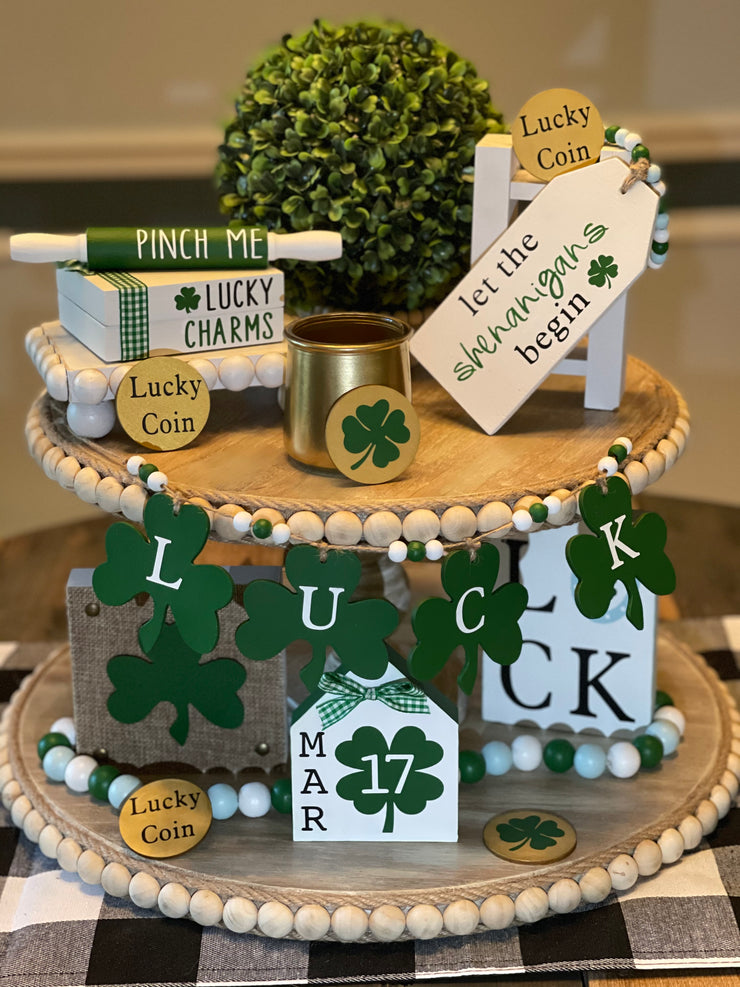 St. Patrick's Day Tiered Tray Set is shown with the 9 piece set.  The Beaded riser and floral greenery are not included).