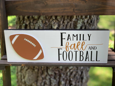Family Fall And Football shows an image of the sign sitting on a ladder outside.