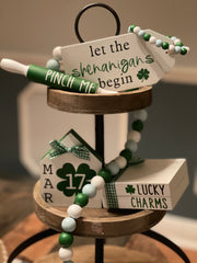 "This is our 5 piece set that includes:  Let the Shenanigans Begin Gift Tag, 7"" mini rolling pin that says ""Pinch Me"", a mini house that reads ""MAR 17"", a lucky charms wood book stack, and a 35"" wood bead garland."