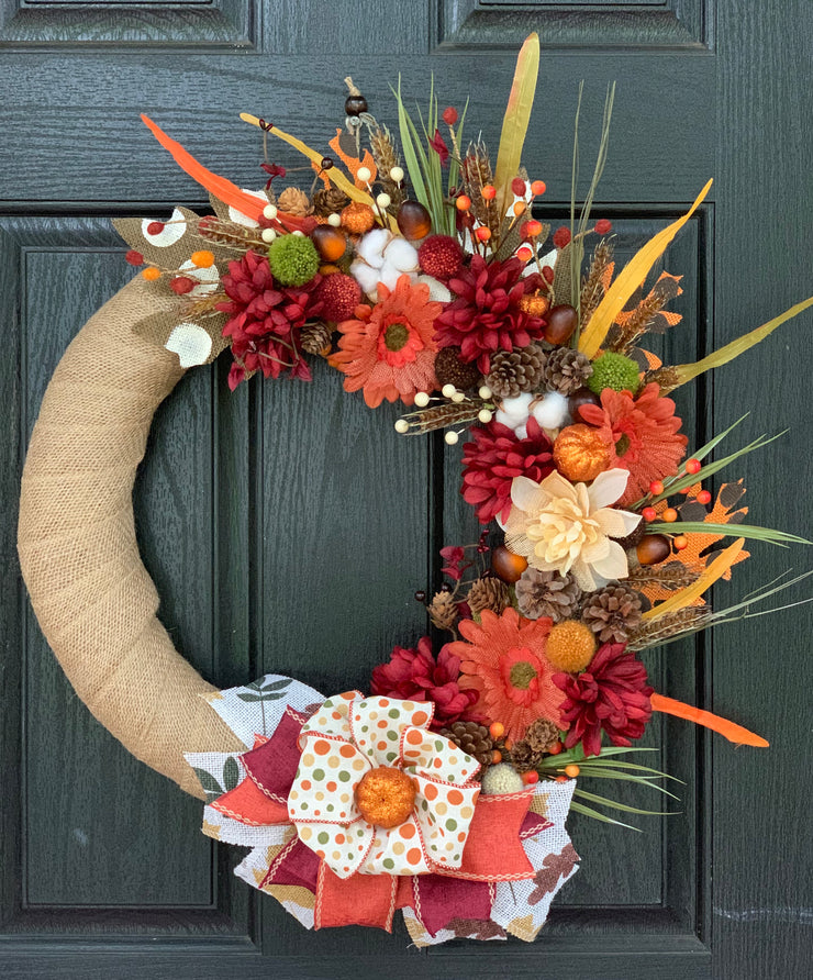 2019 Fall Burlap Wreath shows an image of the wreath hanging on a front door.