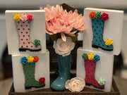 Our Wooden Rain Boot is a 3D cut out with mini rosettes attached.  These make a beautiful display in any tiered tray decor, or as an added embellishment to any decor.  Comes in light pink, dark pink, ocean blue and green. Purchase individually or as a set.