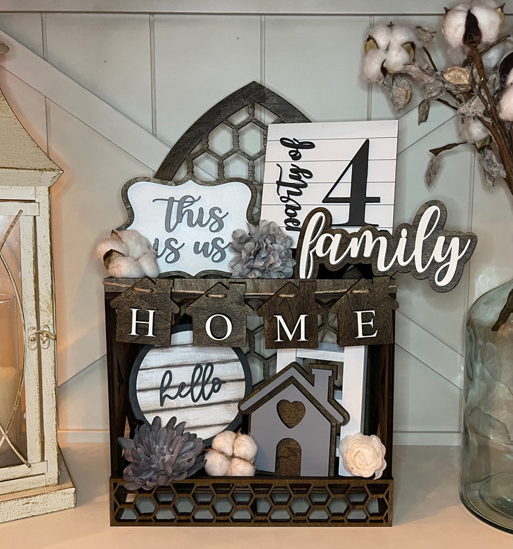 This home tiered tray set in shown in our new Cathedral two tiered tray.  This five piece set comes with This is us mini sign, a 5x5 square party of 4 mini sign, a family script sign, a 3D mini cutout house, and the mini home banner.  The five piece set can be purchased together or individually.