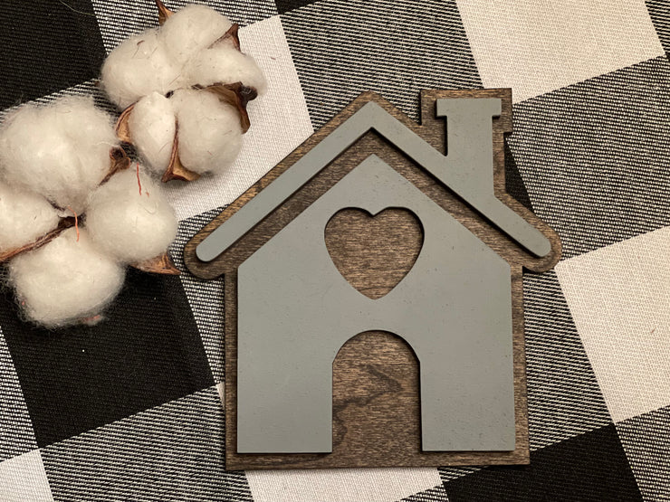 This image shows the mini house cutout sing displayed with mini cotton stems, not sold with product.