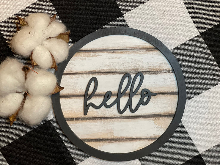 "Our 3D hello 5"" round shiplap sign has a script hello wood cutout attached to the mini shiplap wood sign.  With a black cutout round wood boarder, this sign screams cuteness!  Add to any tiered tray, vignette, or shelf.  Works best with a mini easel, which is sold separately."