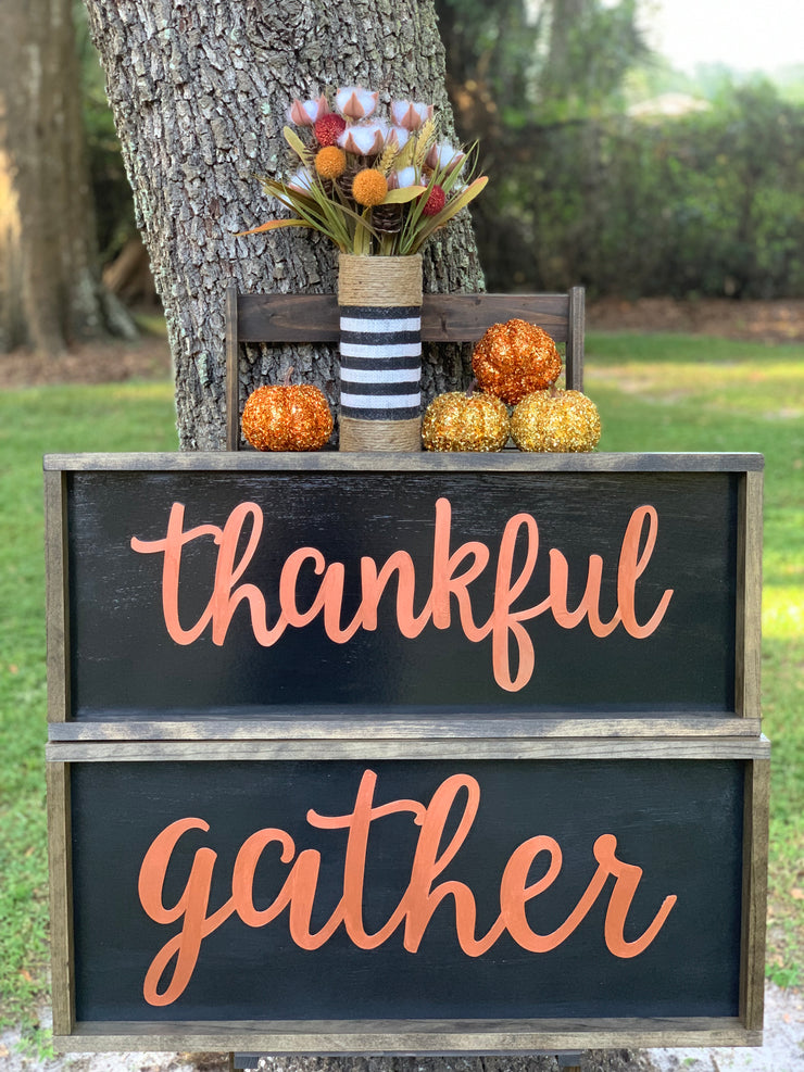 Metallic Thankful Sign shows an image of the sign paired with the Gather sign and the burlap glass container.  Each item sold separately.