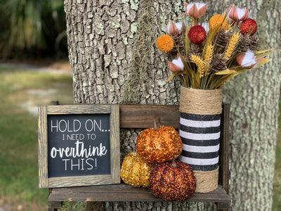 Hold On..I Need To Overthink This! shows the sign paired with the black and white stripe burlap glass container with embellishments.  Container and sign each sold separately.