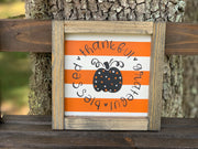 Orange and White Stripe Thankful, Grateful, Blessed (Pumpkin) shows a picture of the sign sitting outside on a ladder.