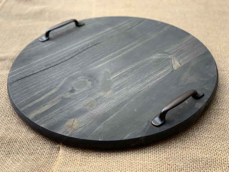 Round Wood Tray with Metal Handles shows an image of the tray at a side angle.