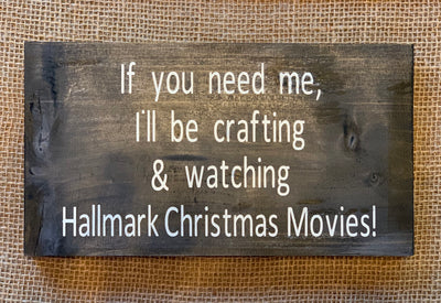 If You Need Me, I'l be Crafting & Watching Hallmark Christmas Movies shows an image of the sign sitting on a table.