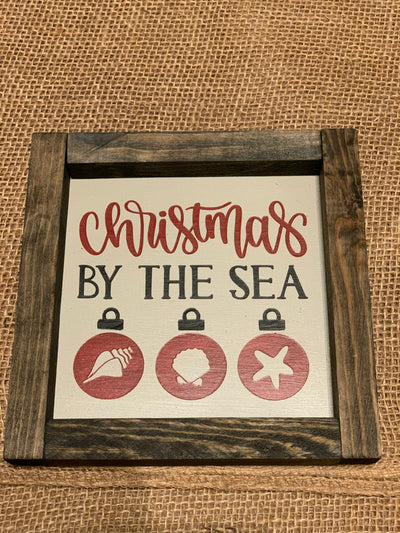 Christmas By The Sea shows an image of the sign sitting on a table.