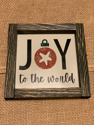 Joy To The World shows an image of the sign sitting on a table.