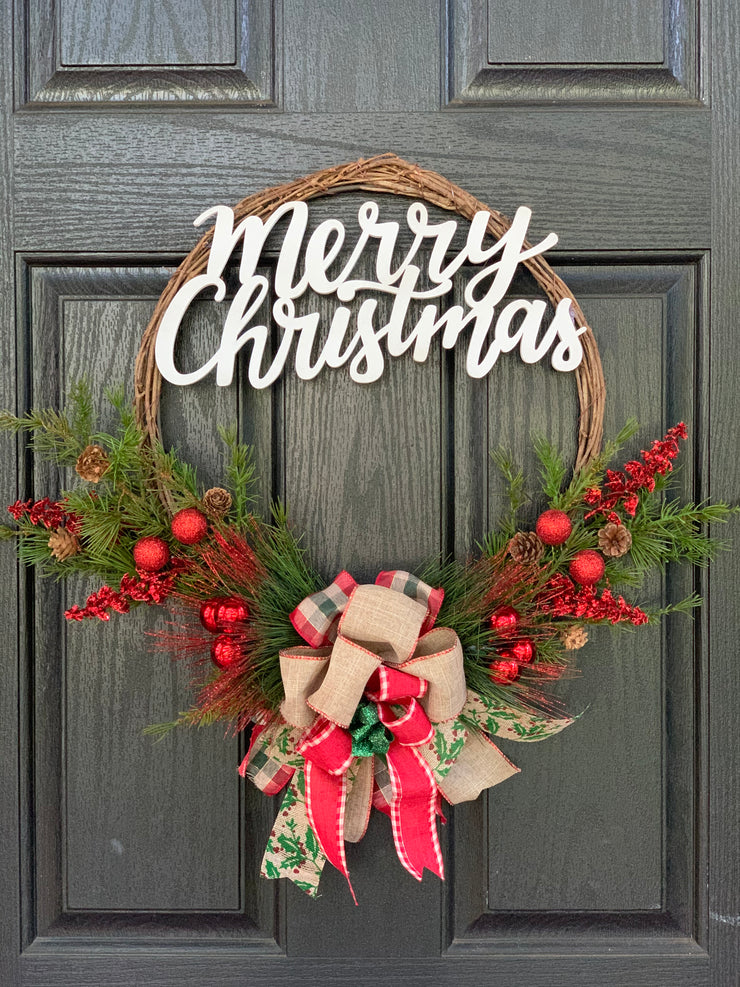 Merry Christmas Wood Script Wreath is shown as a display hanging on a front door.