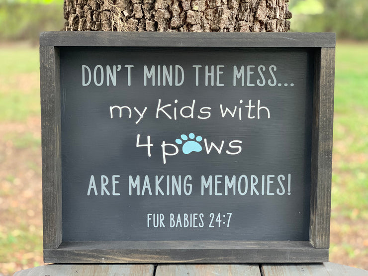 Don't Mind The Mess, My Kids With 4 Paws Are Making Memories (Fur Babies 24:7) shows an image of the sign displayed outside on a table.