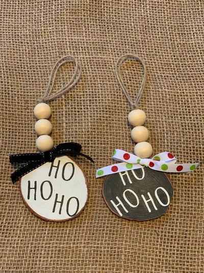 Ho Ho Ho Wooden Beaded Ornament shows an image of the white and black ornaments.  Each ornament sold separately.