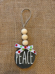 Peace Wooden Beaded Ornament shows an image of the black ornament.