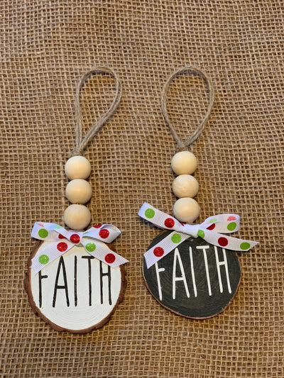 Faith Wooden Beaded Ornament displays an image of the white and black ornaments. Each sold separately.