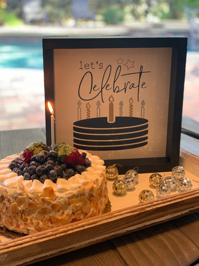 Let's Celebrate (Birthday/Anniversary Sign) is shown sitting on a tray with a celebration cake.  Sign is sold separately than tray in photo.