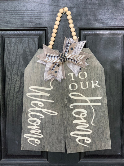 Welcome To Our Home Gift Tags sign is shown hanging on the front door, ready to welcome guests.