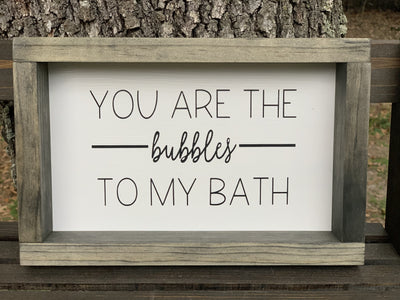 You Are The Bubbles To My Bath is shown sitting on a ladder outside.