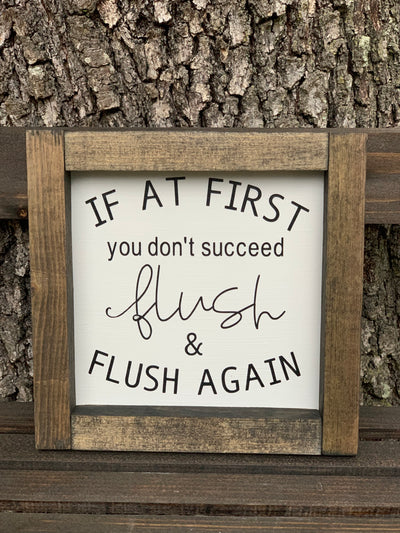 If At First You Don't Succeed, Flush & Flush Again shows the sign displayed outside on a ladder.